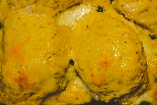 cheesy baked chicken out of the oven