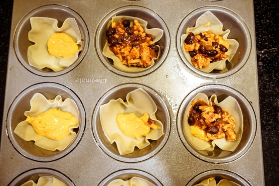 wonton wrappers with taco mix and salso con queso