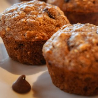 chocolate chip muffins on a white plate