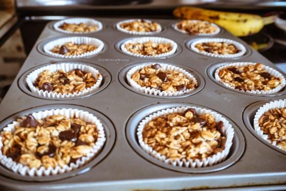 baking sheet with banana chocolate chip muffins and banana