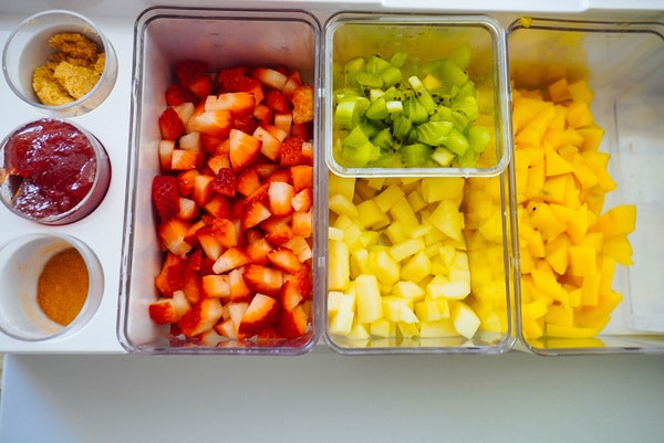 cut up fruit ingredients for fruit salsa in a prepdeck