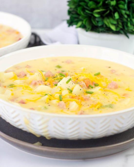 ham and potato soup in a white bowl