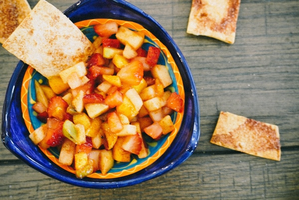 fruit salsa with a cinnamon chip in a festive blue bowl