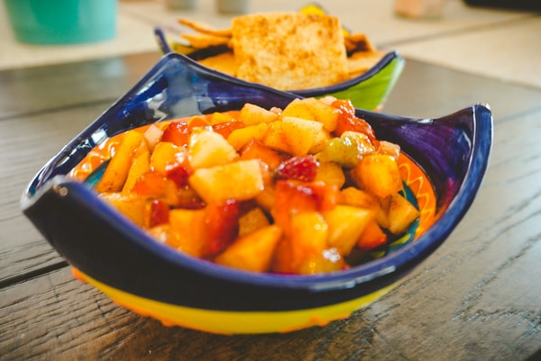 fruit salsa closeup in festive blue and yellow bowl