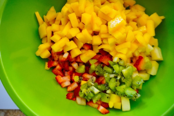 fruit salsa in a green mixing bowl