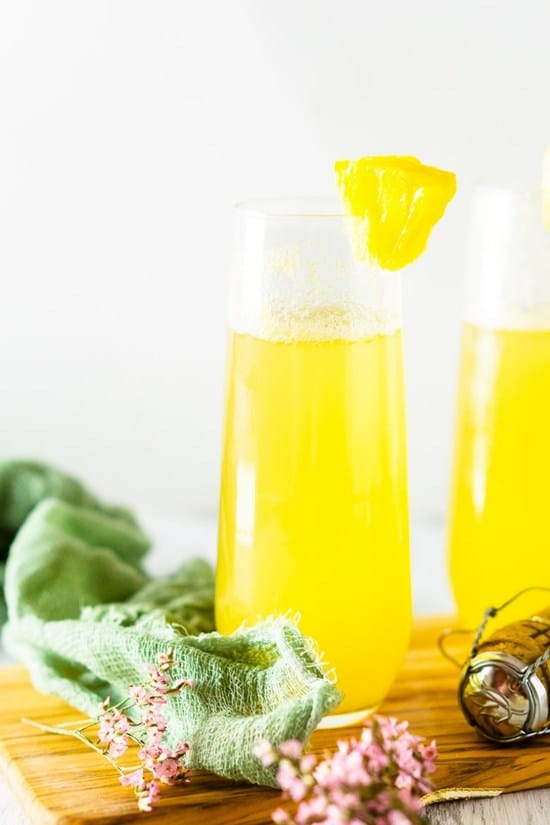 pineapple mimosa in glasses with cork on the side