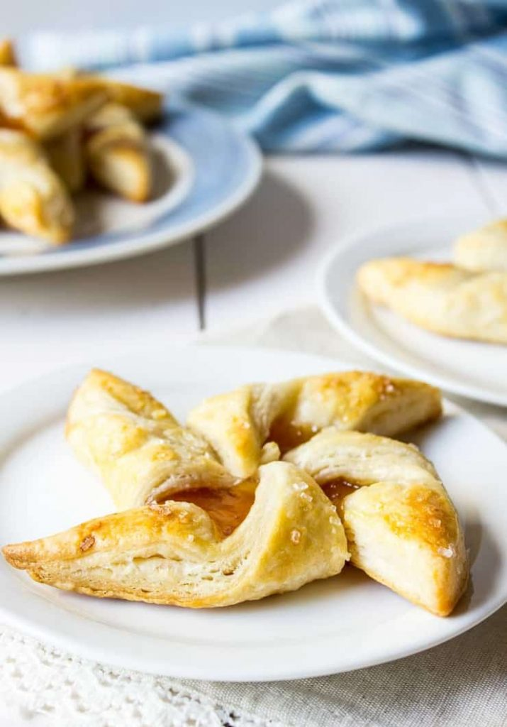puff pastry pinwheels on a white plate