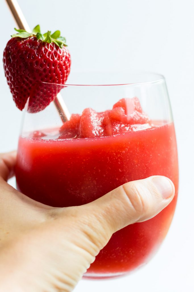 close up of strawberry frose with hand