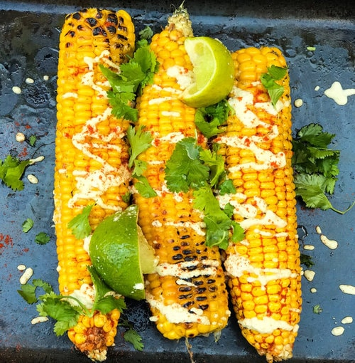 grilled vegan corn on the cob with garnish
