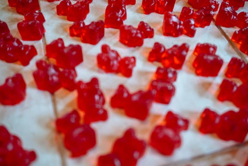 gummy bears laying down on white table