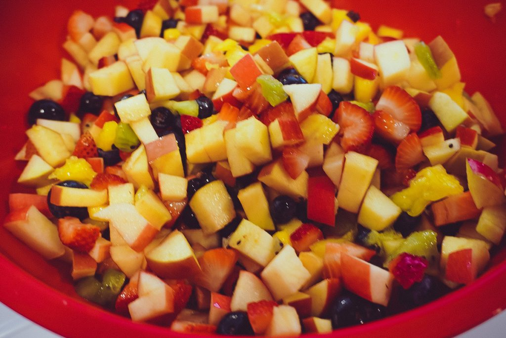 fruit salad in a red bowl