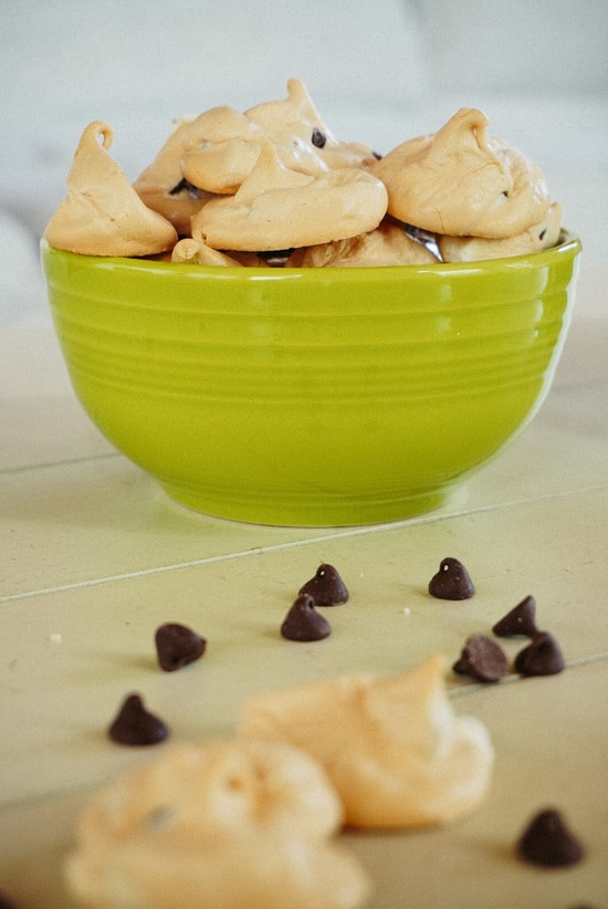 green bowl filled with chocolate chip meringue cookies