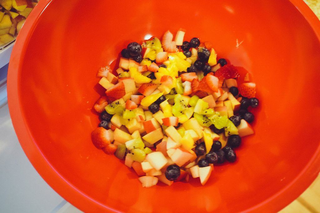 mixed fruit in red bowl
