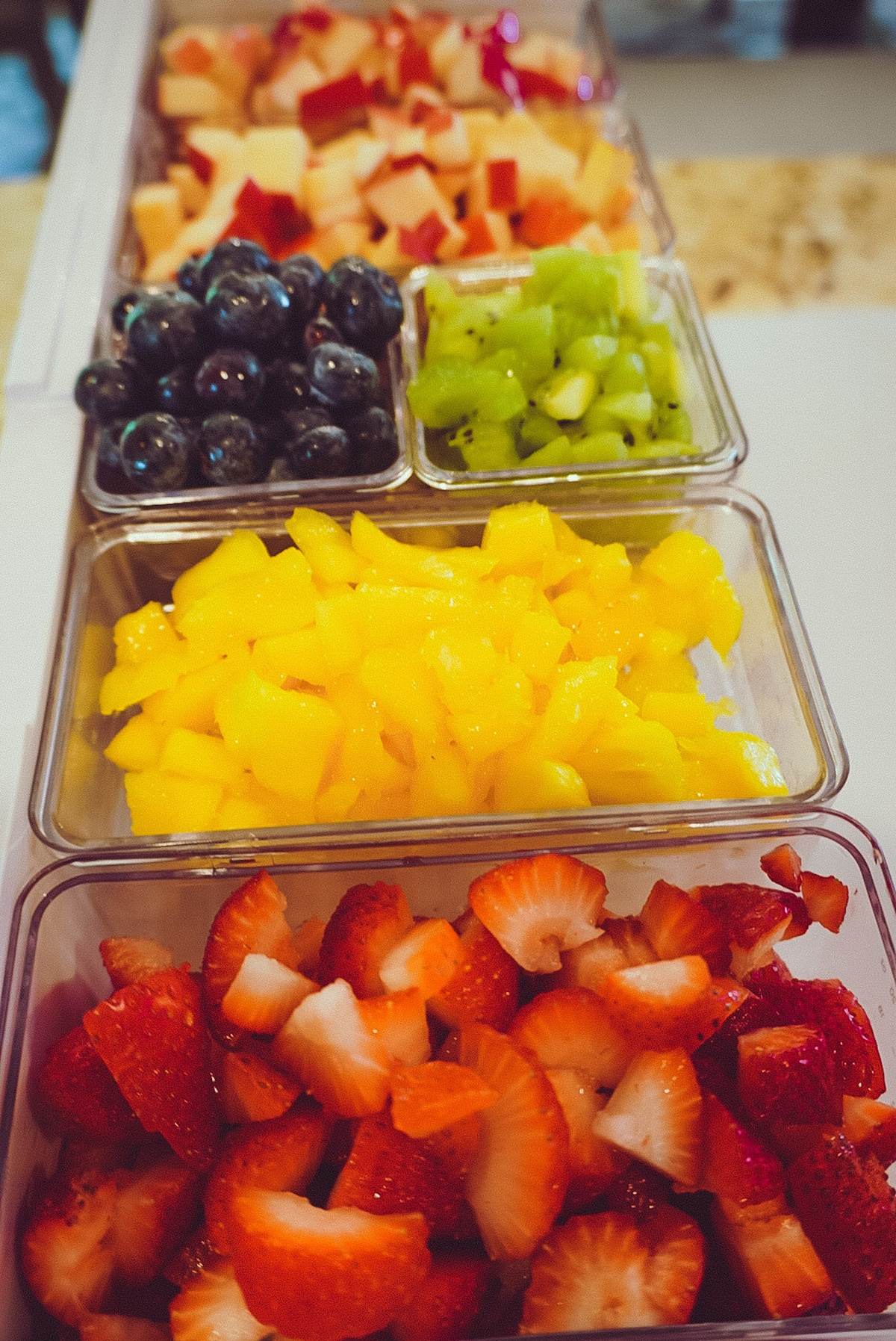 close up of chopped up fruit in a prepdeck