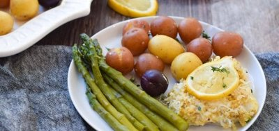 coconut crusted alaskan pollock plated with asparagus and potatoes