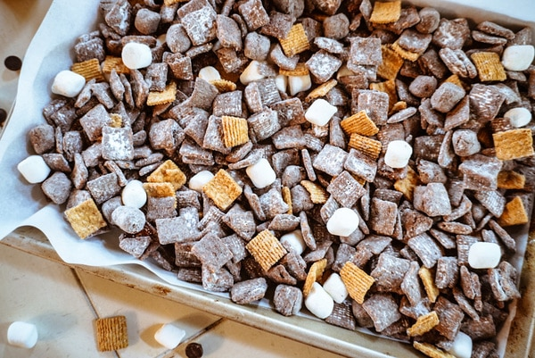smores puppy chow on a baking sheet