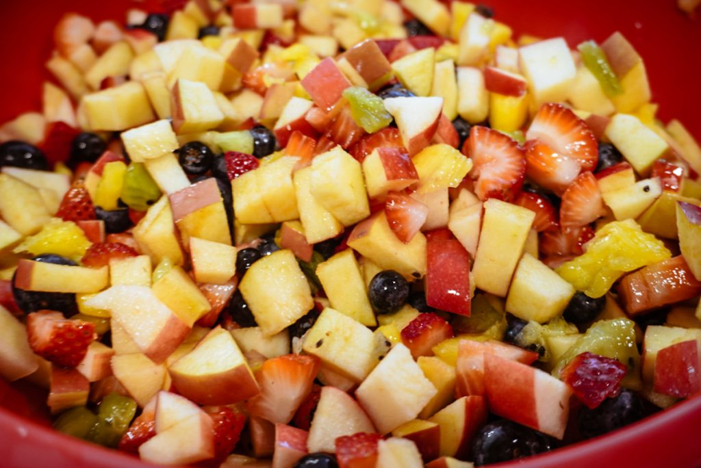 close up of fruit salad in a red bowl