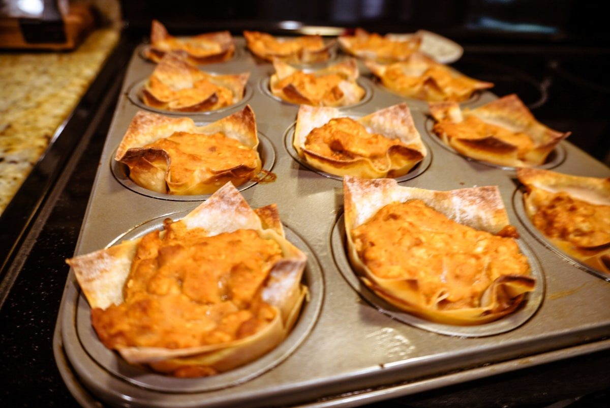 baked chicken burrito cupcakes in a muffin tin