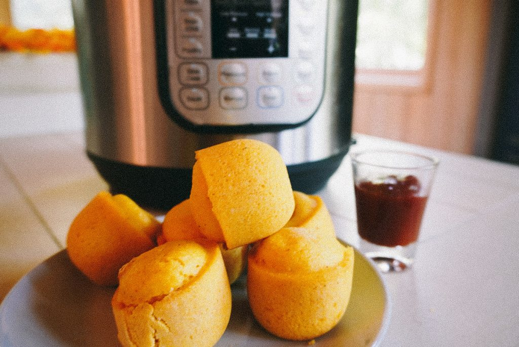 corn dog bites in front of an instant pot