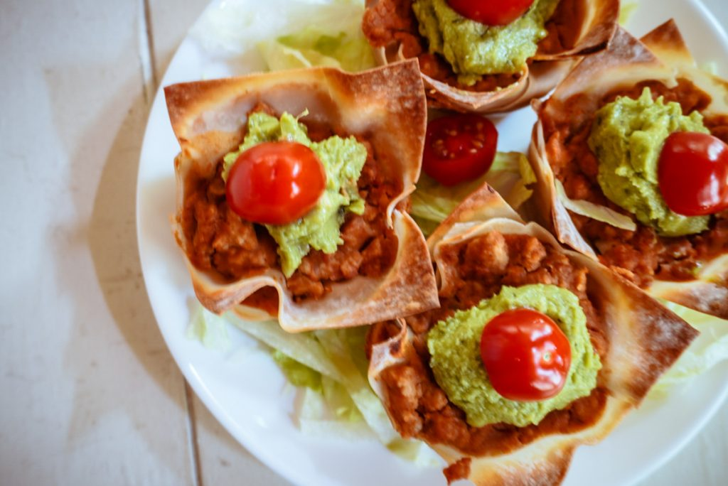 overhead image of burrito cupcakes on a white plate