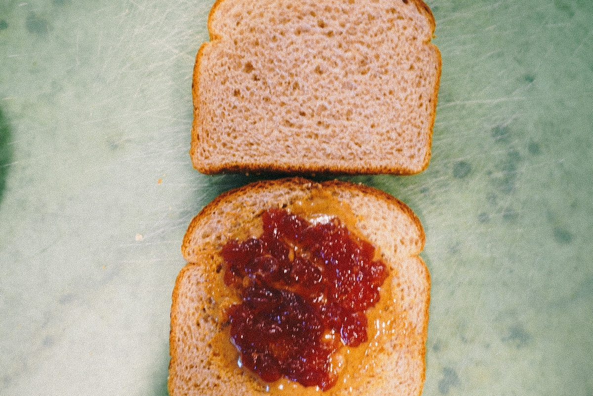 spreading jelly on bread