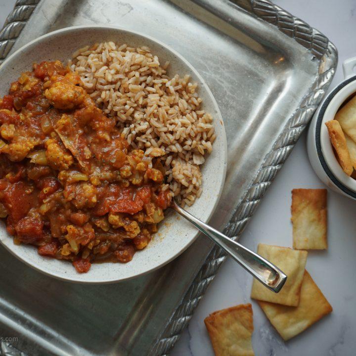 bowl of tikka masala on a decorative silver platter