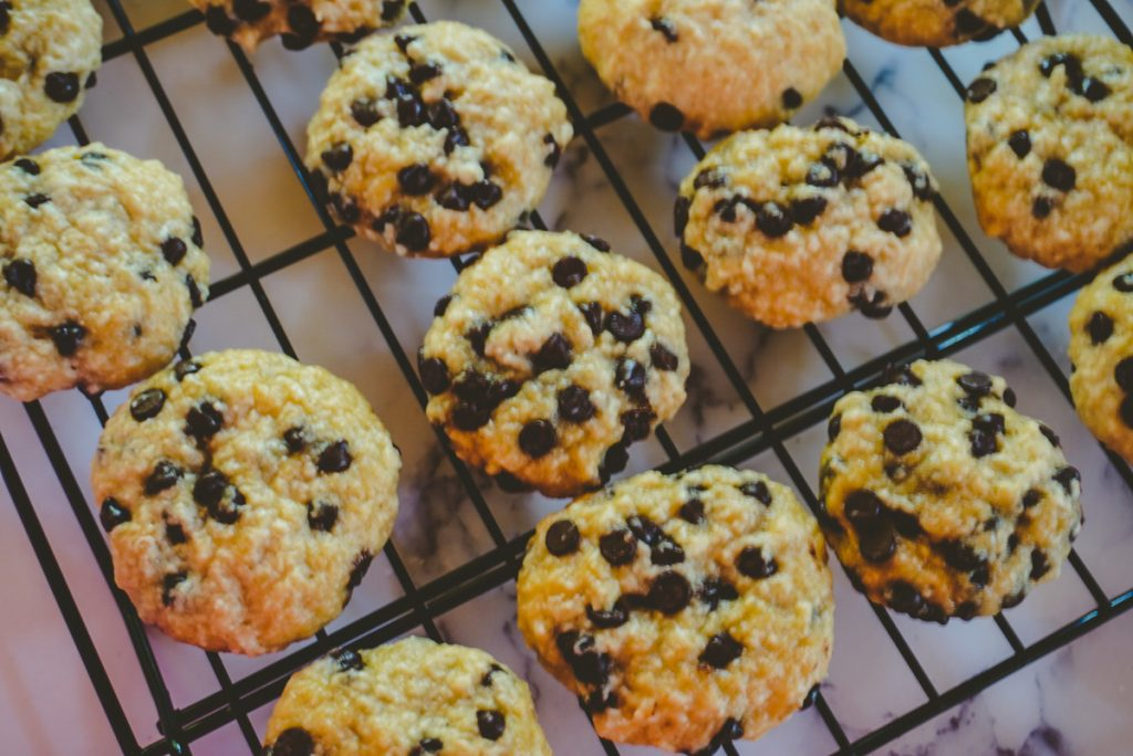 close up of chocolate chip cookies on a cooling tray