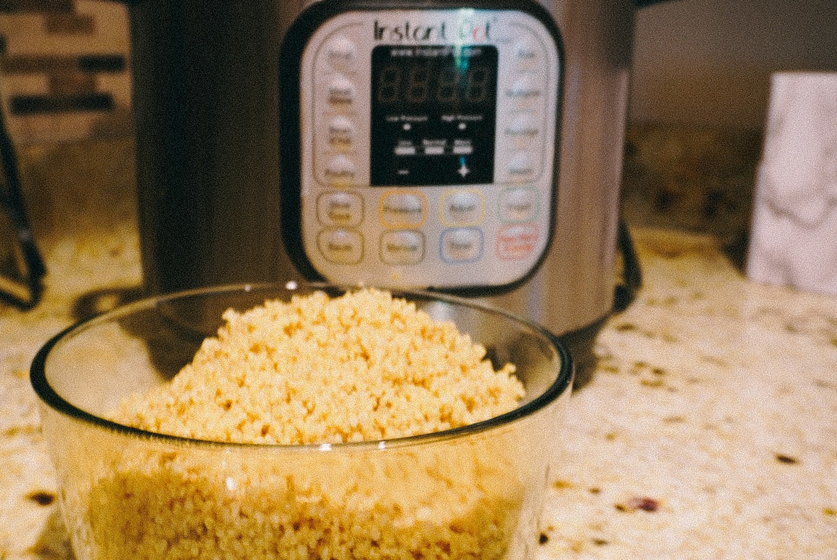 quinoa in a bowl in front of the instant pot