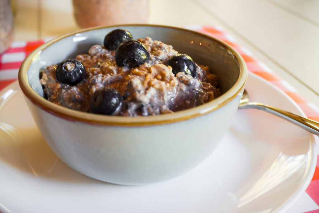 overnight oats with a blueberry on top