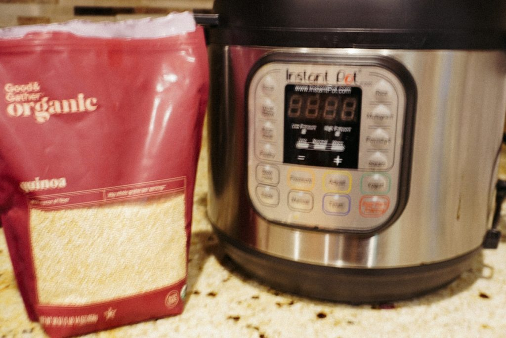a bag of quinoa next to instant pot