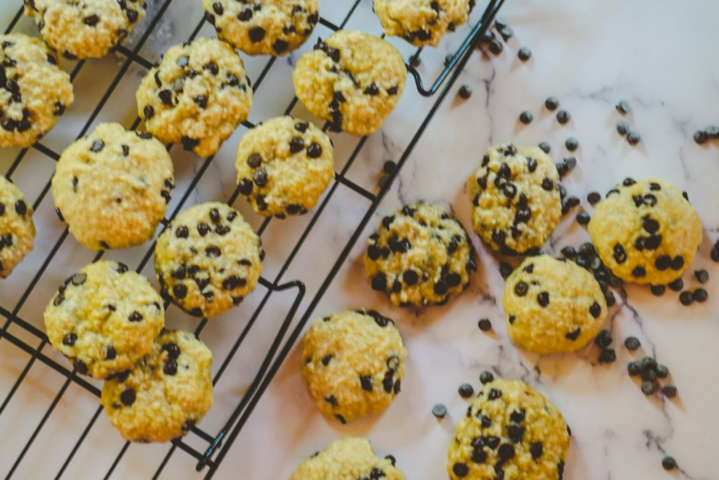 chocolate chip cookies on a tray and table
