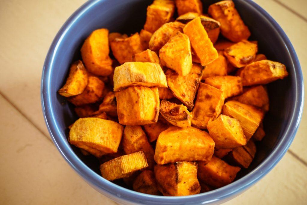 overhead airfryer sweet potatoes in blue bowl