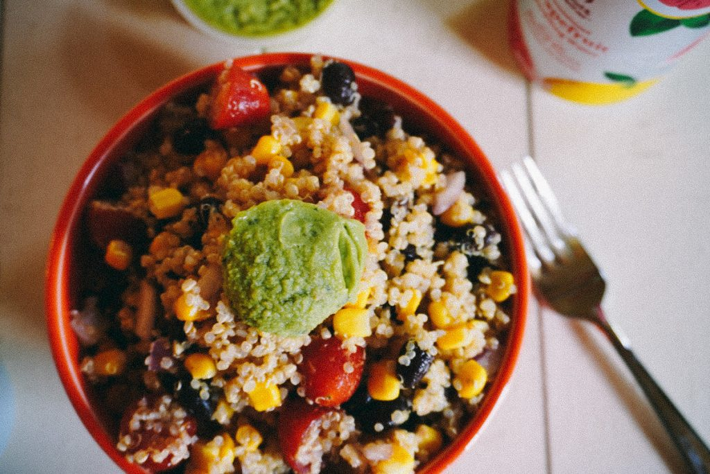 overhead of southwest quinoa salad with guacamole