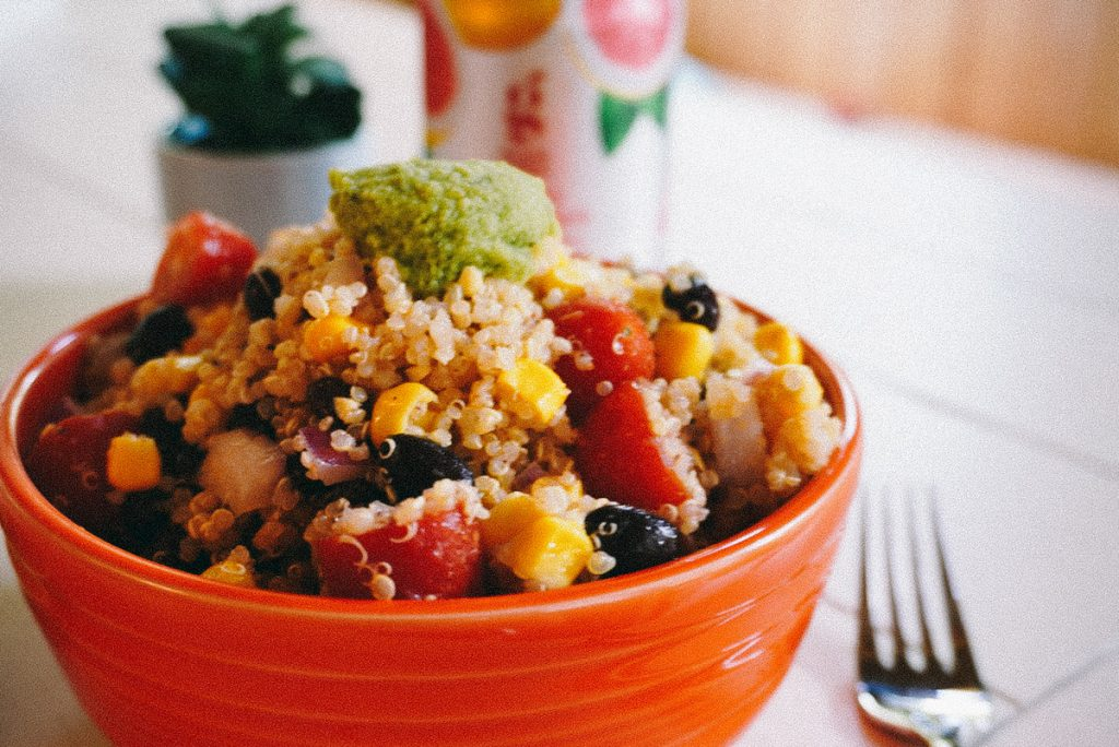 southwest quinoa salad in an orange bowl