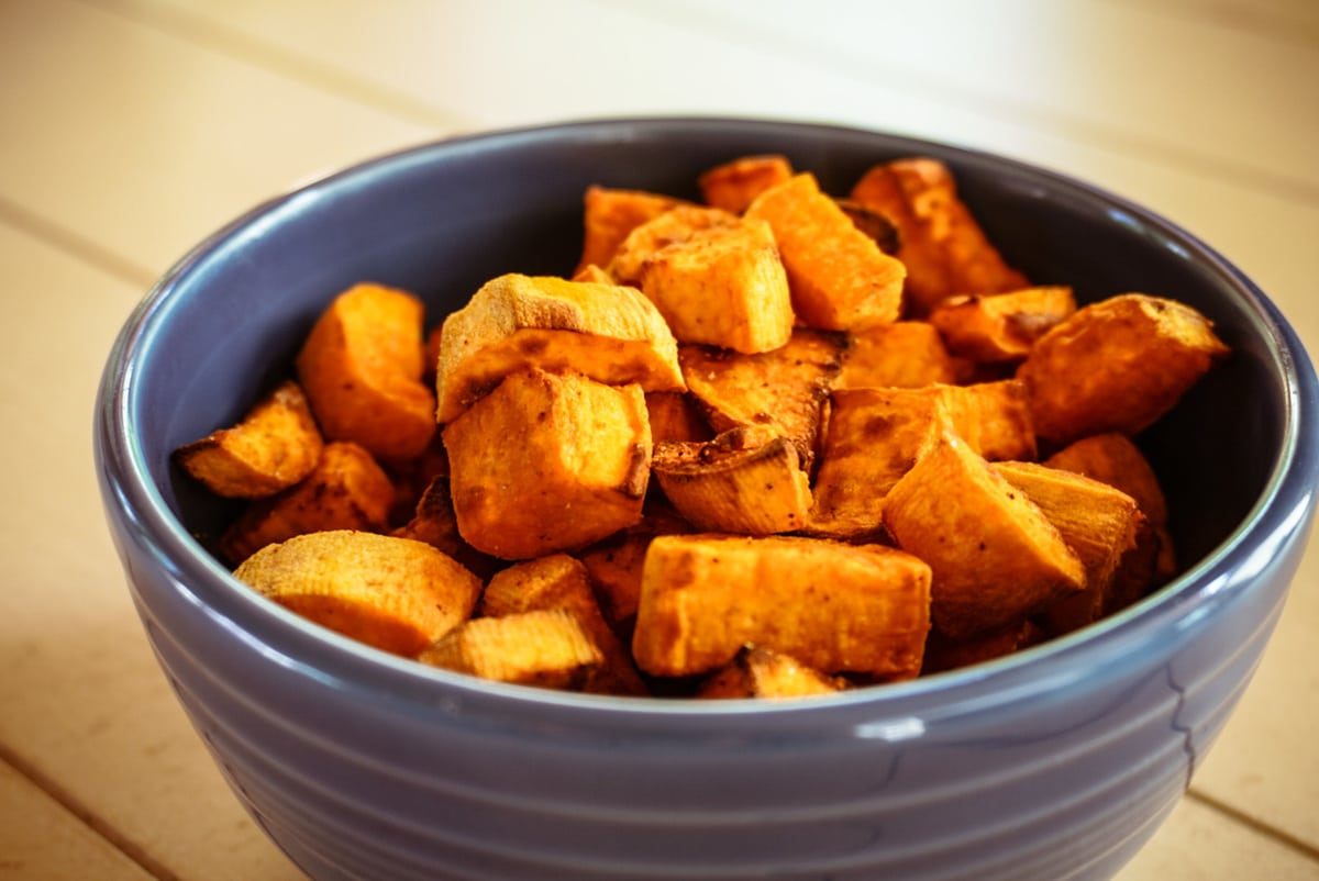air fried sweet potatoes in a blue bowl