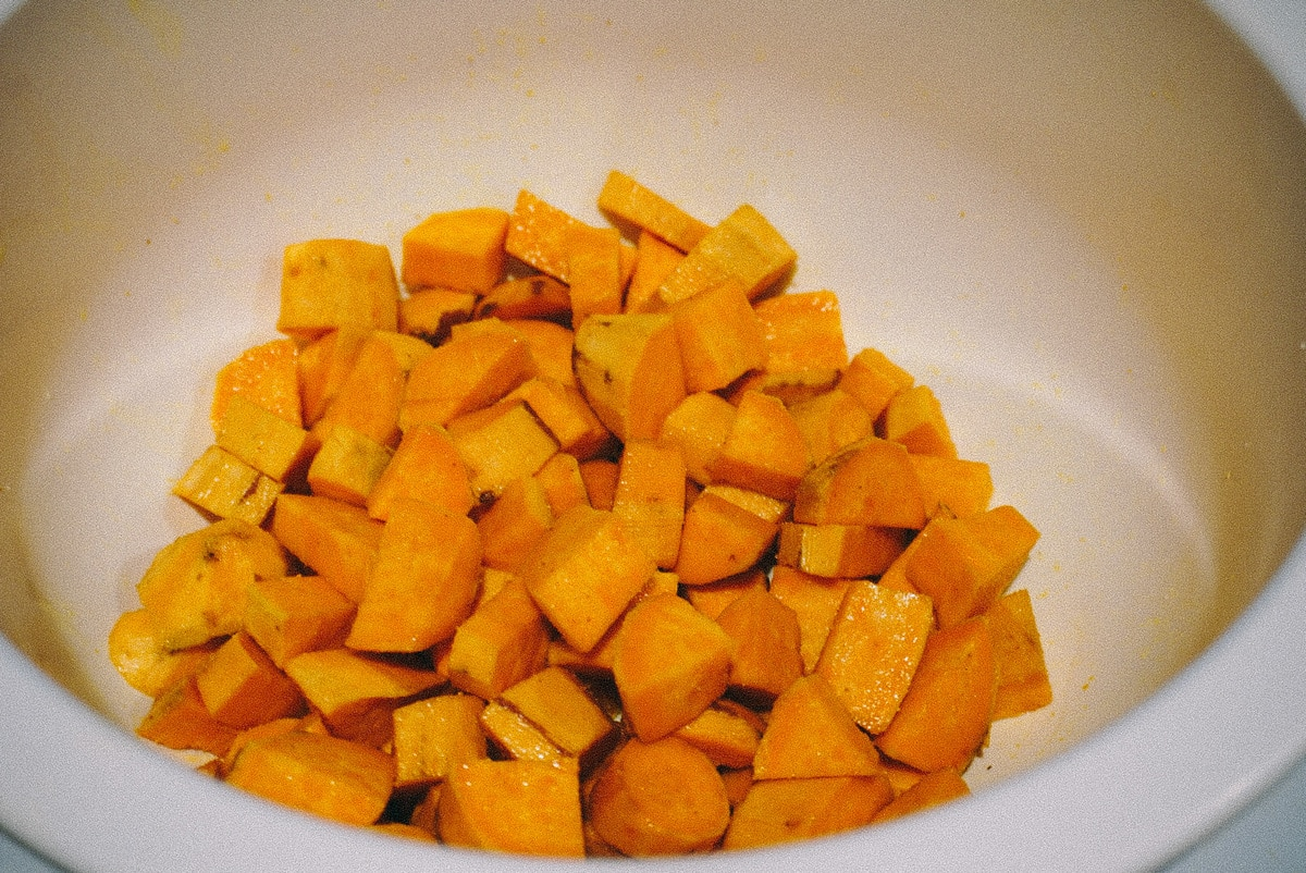 raw sweet potatoes in a white bowl