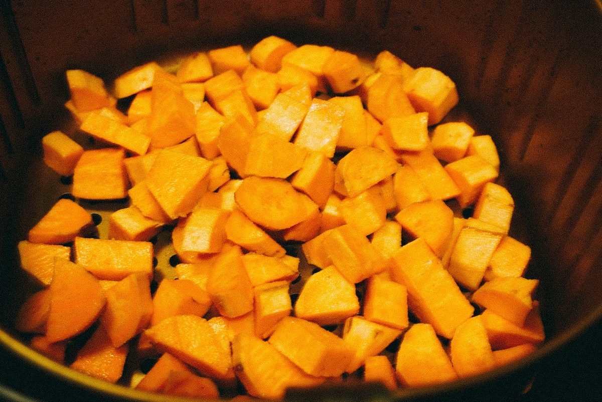 sweet potatoes in an air fryer before cooking