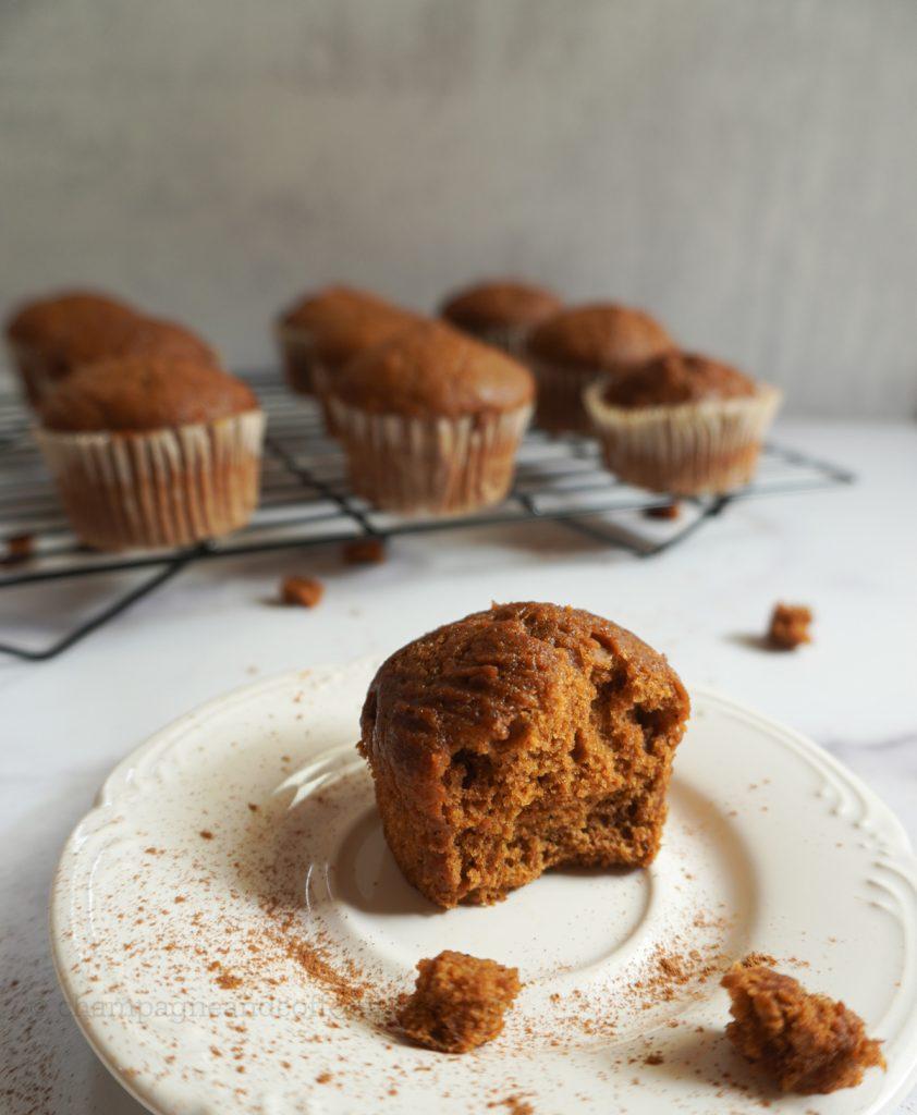 half a pumpkin spice muffin on a plate