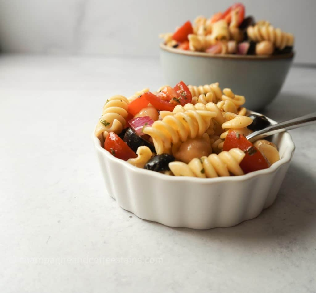 side view of pasta salad in a white bowl