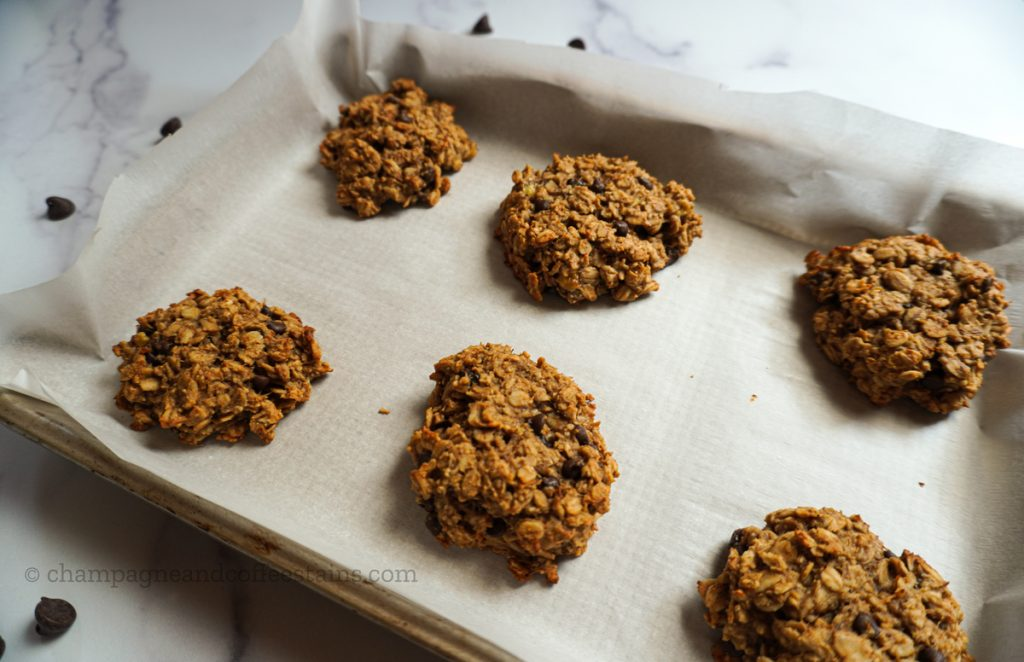 peanut butter banana cookies with chocolate chips on parchment paper and tray