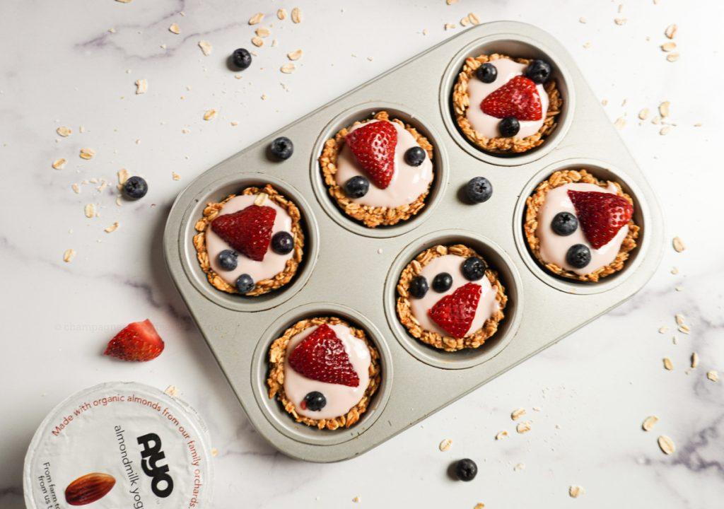 overhead yogurt parfait granola cups in a muffin tin