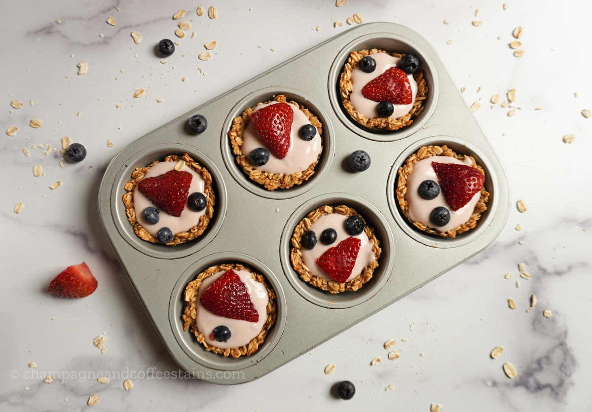 granola cups with fruit inside a muffin tin