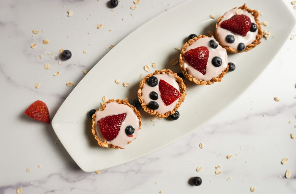 granola cups on a white plate