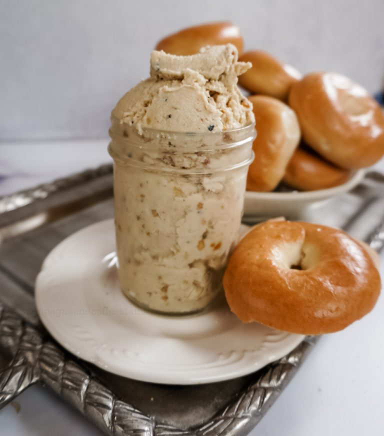 a jar of vegan everything cream cheese with a bagel