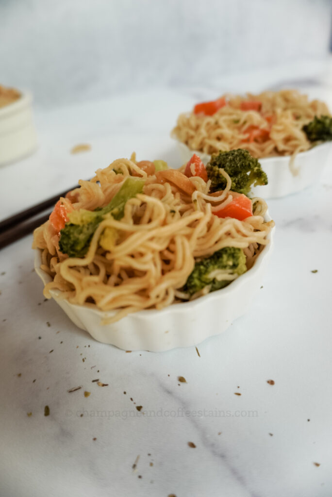 side thai noodles in a white bowl with broccoli