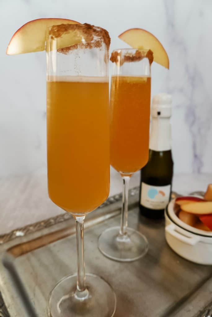apple cider mimosas on a tray