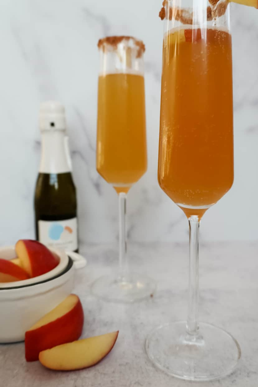 apple cider mimosas with apples on the side