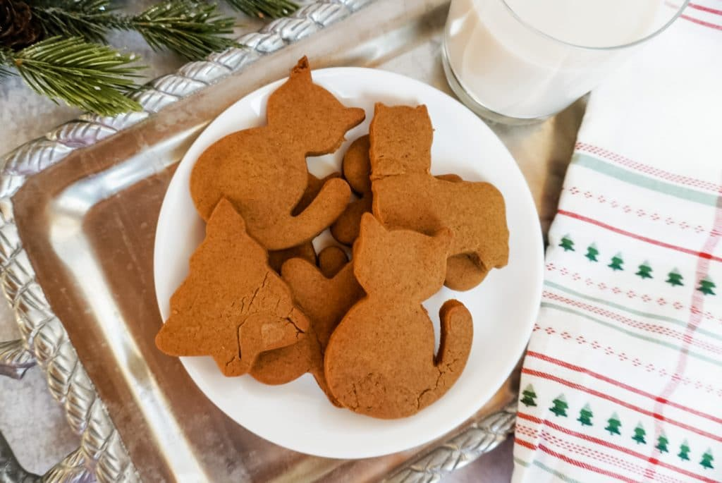 a stack of gingerbread cookies on a white plate