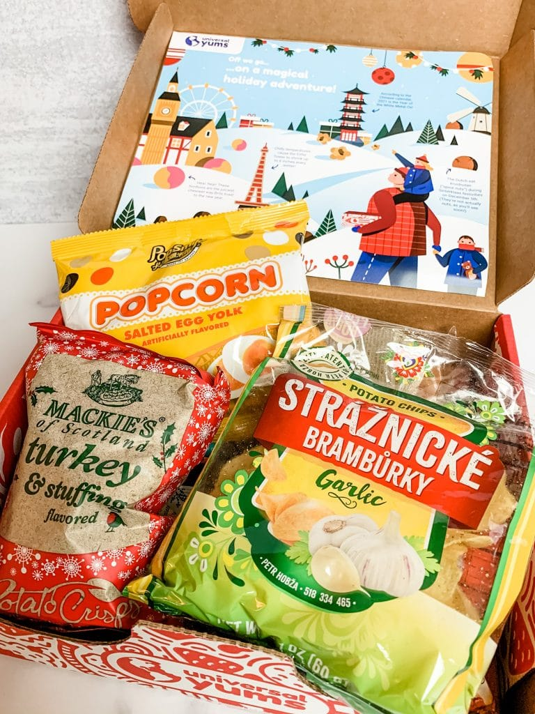opening the universal yums holiday 2020 snack box