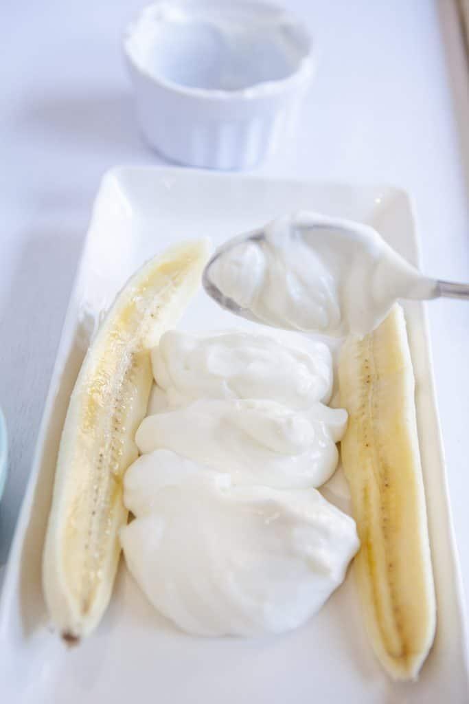 layering the yogurt on top of the banana